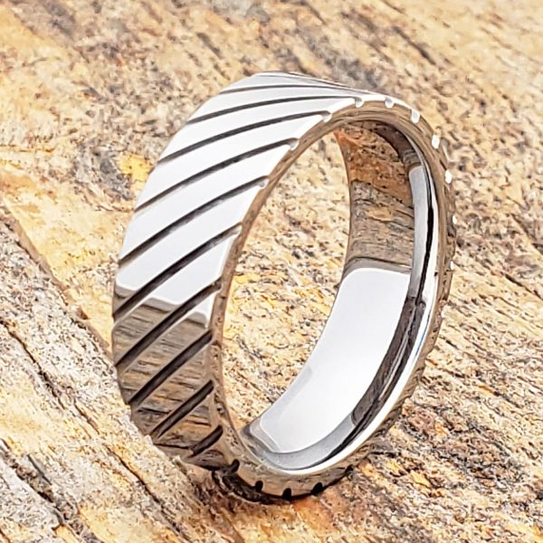 carina-diagonal-grooved-7mm-unique-rings